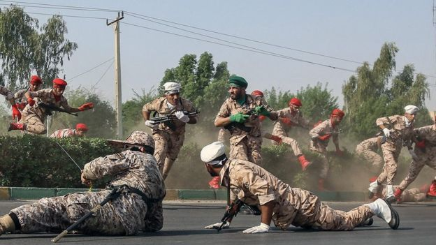 Soldiers run for cover during the attack