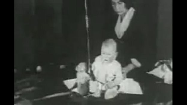 Little Albert in front of a monkey during an experiment in 1920. Image taken from a public domain video according to wikimedia.