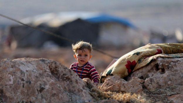 A newly displaced Syrian child near a refugee camp in Atimah village, Idlib province