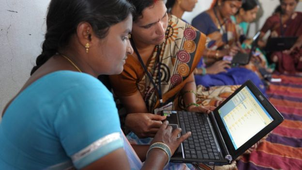 Indian villagers from a self-help group with laptops in Bibinagar village outskirts of Hyderabad on 7 March 2013