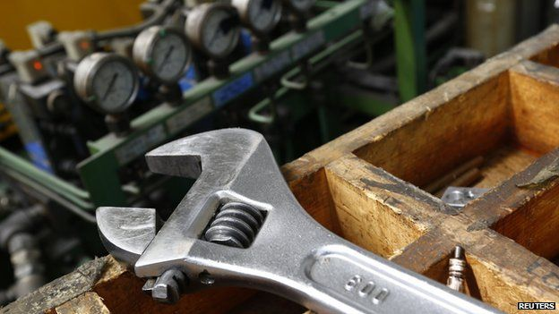 A wrench on a workbench