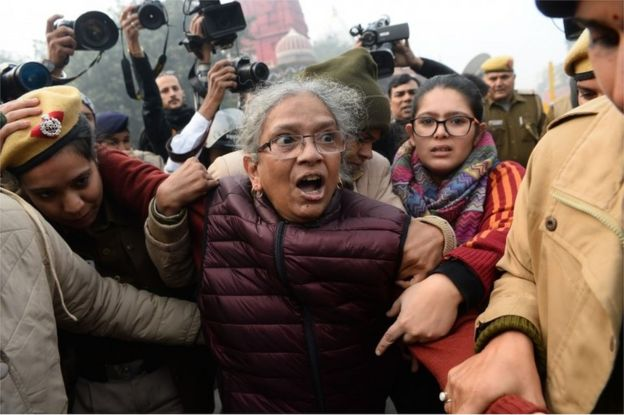 A woman reacts as she confronts police at a demonstration against Indias new citizenship law in New Delhi on December 19, 2019