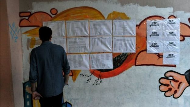 A man checks his name to vote at a polling station in Thessaloniki, on 20 September 2015.