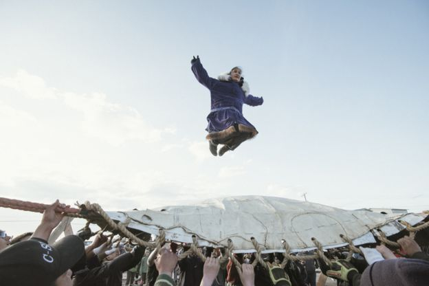 At Nalukataq, the summer whaling festival, the village comes out to celebrate a successful whaling season and to give thanks to the whale for its gift. Here, successful crewmembers do the blanket toss They are thrown up to thirty feet in the air, and depend on everyone's hands to land safely.