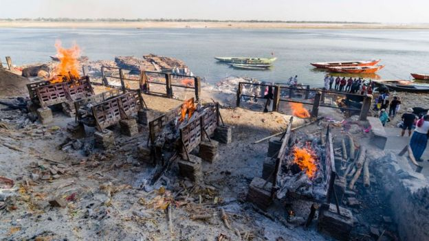 A funeral pyre along the river Ganges in Varanasi