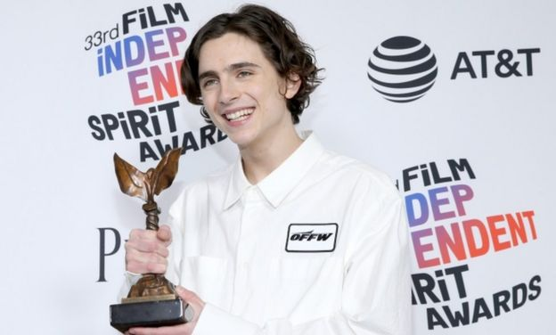 Timothee Chalamet beams with his award