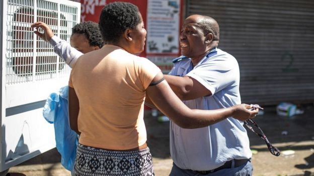 Policeman confronting a woman