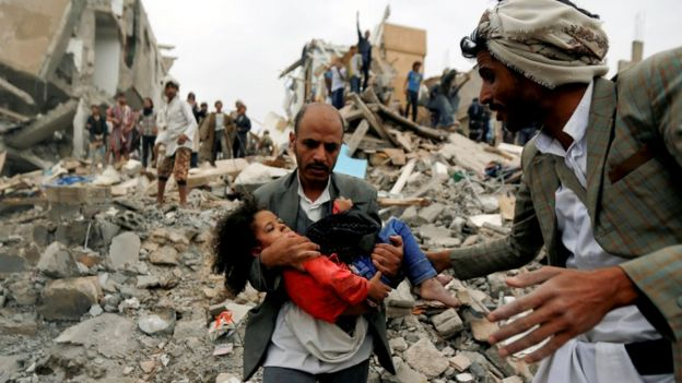 Buthaina Muhammad Mansour being rescued from the site of a Saudi-led air strike on Sanaa which killed eight of her family members.