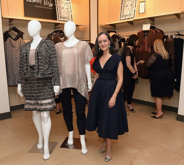Isabel Toledo standing next to her plus size designs. displayed on mannequins, for Lane Byrant in 2014