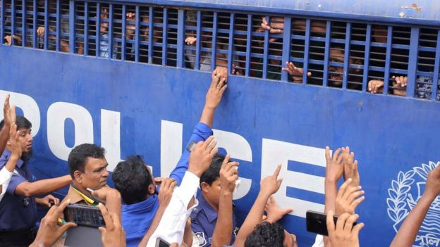 Accused people are seen inside a prison van after they were given death sentences in a murder case in Feni, Bangladesh