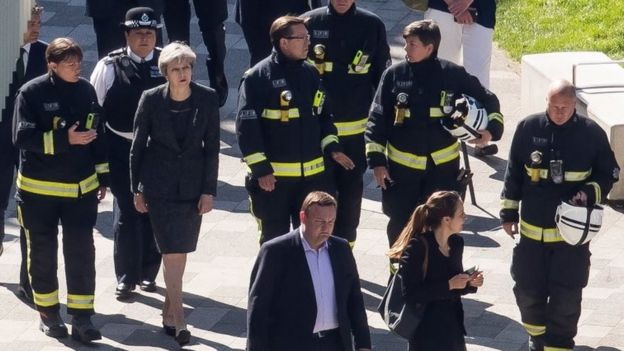 Prime Minister Theresa May with firefighters