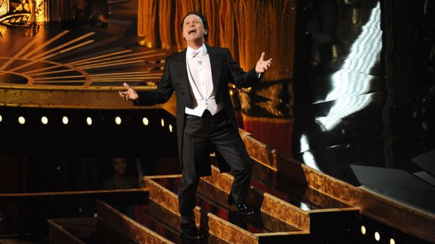 Billy Crystal hosting the Oscars in 2012