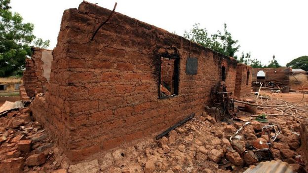 A picture taken on May 10, 2016 in Okokolo-Agatu in Benue State, north-central Nigeria shows a burnt house following attacks by Fulani herdsmen.