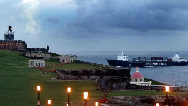 A ship comes into port past the Castillo de San Felipe del Morro April 26, 2004 in Old San Juan, the original capital city of San Juan, Puerto Rico.