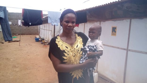 Nigerian Woman carrying child