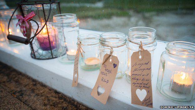Candles laid in tribute on the Adur Ferry Bridge in Shoreham