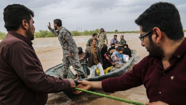Iranian soldiers help evacuate civilians amid unprecedented flooding, March 2019