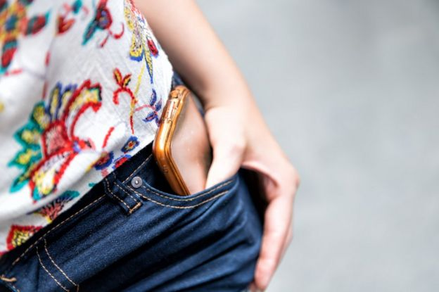 phone in woman's pocket