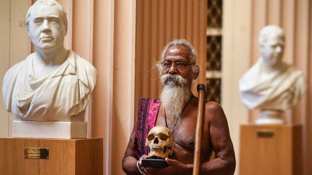 Vedda chief Wanniya Uruwarige with skull