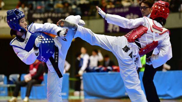 Pelea de taekwondo.