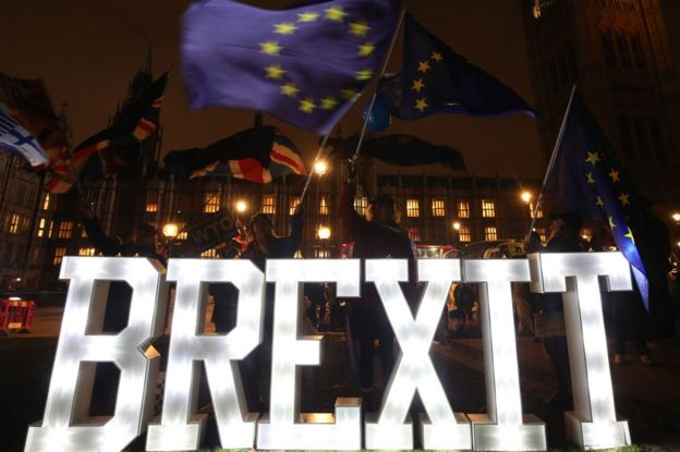 Protesters during a Best for Britain Brexit lights rally outside Parliament in London