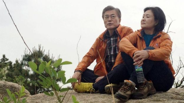 Moon Jae-in and his wife Kim Jung-sook rest on a hillside
