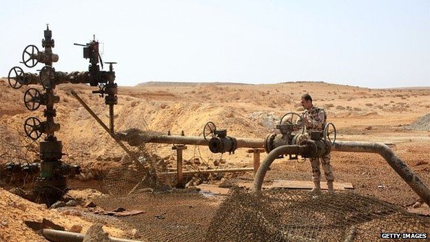 An oil field in Palmyra, Syria, being guarded by a government member.