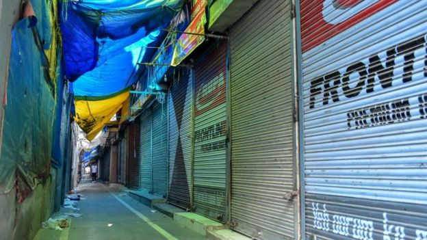 A man walks past closed shops during a shutdown in Srinagar, Kashmir.