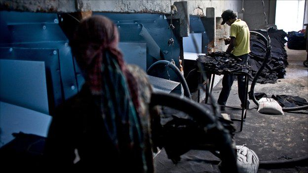Workers at a sandblasting factory in Bangladesh in March 2010. Photo by Allison Joyce.