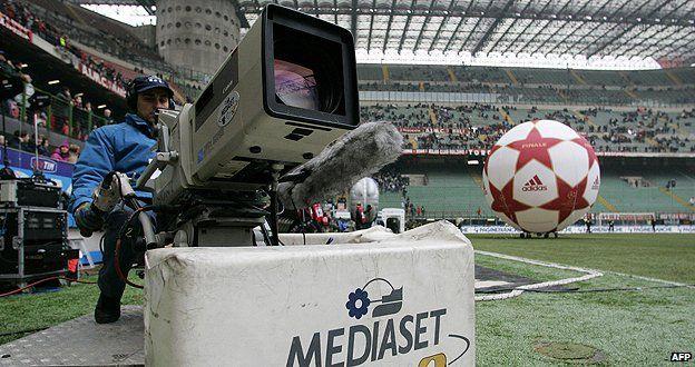 Cameraman at a sports event