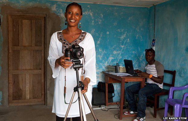Rebecca Kamara in her village studio. Rebecca has set up her own photography business in her village in Sierra Leone, West Africa