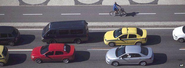 Lone cyclist in traffic