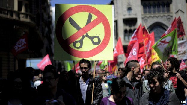 People protest during a May Day rally in the centre of Barcelona