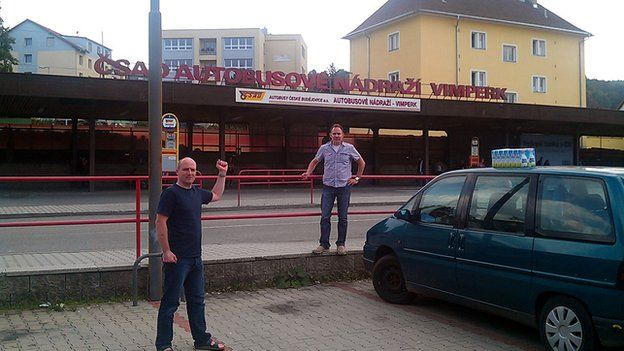 Rob and a friend at Vimperk bus station in 2012