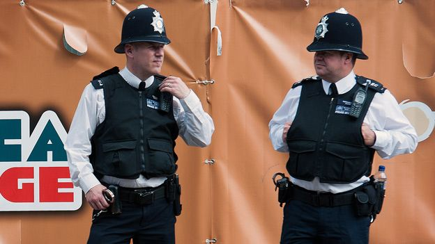 Two police officers - one has a bottle of water in his utility belt