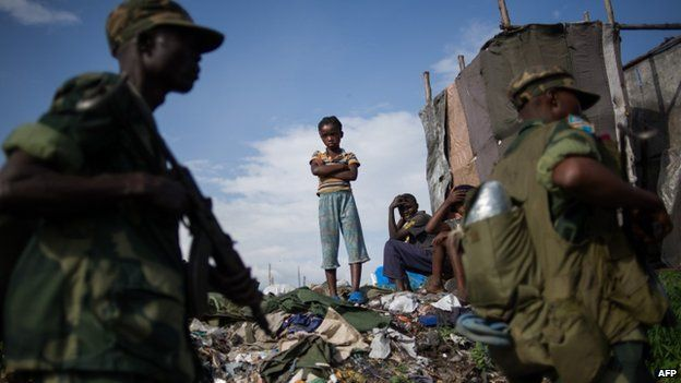 A child watches as Congolese soldiers return to the military barracks in Goma eastern Democratic Republic of the Congo on December 3, 2012.