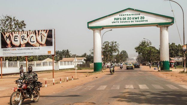 """An arch in the centre of Bangui which reads: """"Centreafrique, pays de zo kwe zo."""""""