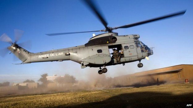 A helicopter carrying French soldiers takes off for an operation in northern Mali
