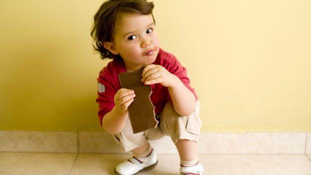 Child with chocolate bar