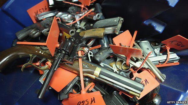 Guns in a pile
