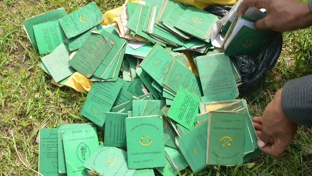 Some of the CCM party membership cards discarded in protest