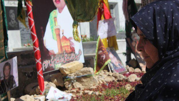 A mourner at a Hazara Shia cemetery in Quetta, Balochistan (2013)