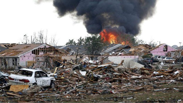 A fire burns in the Plaza Towers Elementary School in Moore