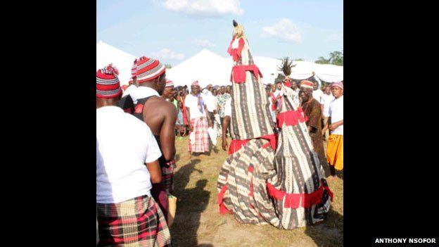 Masquerades at an Igbo funeral in Nigeria