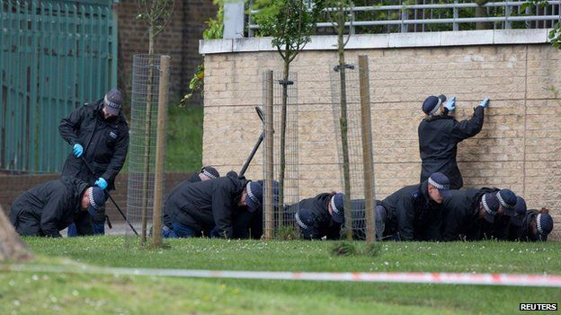 Police carry out a fingertip search