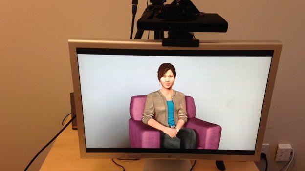 A computer screen shows a virtual image of a woman.
