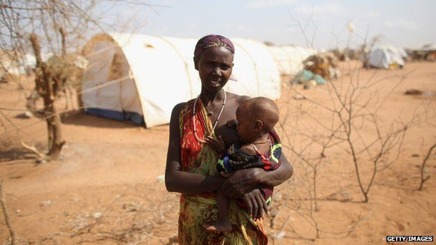 A woman breastfeeding her malnourished child