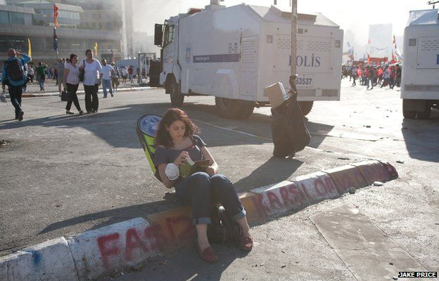 A protester reads a book