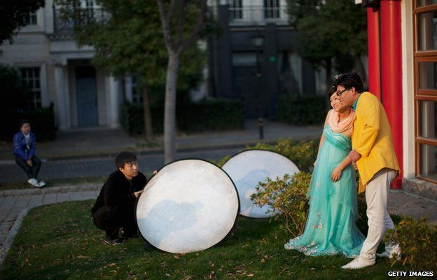 A couple posing for photos in Thames Town, China
