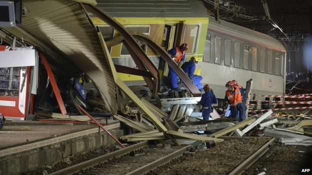 Mangled platform roof and train at the scene of the crash at Bretigny sur Orge, 13 July 2013